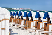 Many wicker beach chairs in a row on the german baltic sea beach — Stok fotoğraf