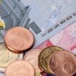Stock Photo: Euro coins and banknotes