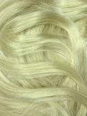 Blond hair curls as texture background — Stock Photo