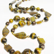 Tiger eye yellow and brown beads — Stok Fotoğraf #10789514