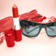 Women accessories red gloves sunglasses and lipstick — Stock Photo