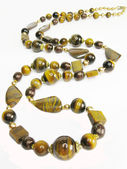 Tiger eye yellow and brown beads — Stock Photo
