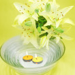 Water for spa with lily bunch - Stok fotoğraf