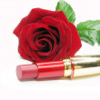Red lipstick with rose on background - Stock Photo