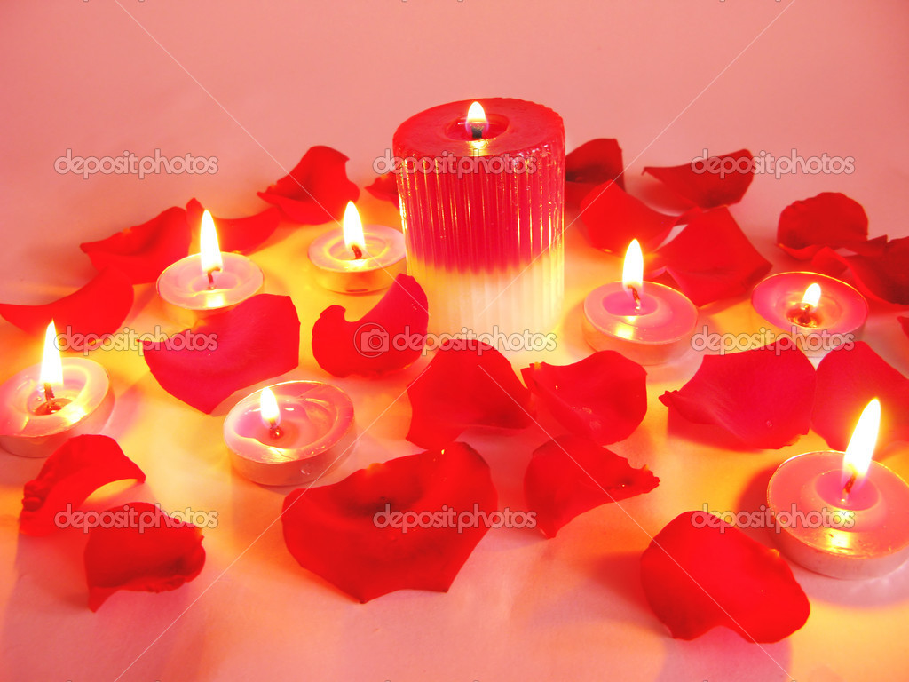 Spa lit candles among damask rose petals — Stock Photo #10864293