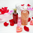 Stock Photo: Spa bowl with rose petals and oil essences