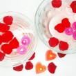 Spa bowls with red rose petals and candles — Stock Photo