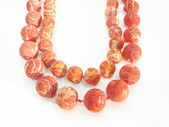 Red colored coral beads — Stock Photo