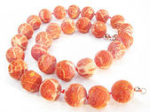 Coral colored beads — Stock Photo