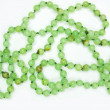 Stock Photo: Heap of green colored beads