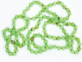 Heap of green colored beads — Stock Photo