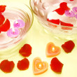 Stock Photo: Spcandles red rose petals