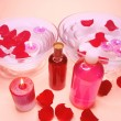 Spa bowl with rose petals and oil essences — Stock Photo