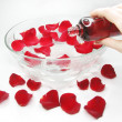 Hand in plate with rose petals — Stock Photo #11035234