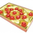 Sweets in red envelopment in gold box — Stock Photo