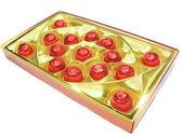 Snoepjes in rode envelopment in goud vak — Stockfoto