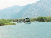 Boats in dalyan river turkey — Stock Photo