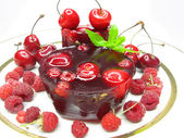 Cherry jelly dessert with berries — Stock Photo