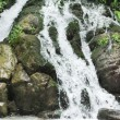 Waterfall out of grotto — Stock Photo