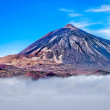 Mt Teide rising above the clouds - Stock Photo