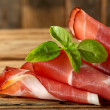 Leaves of basil and ham - Stock Photo