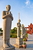 Statues of buddhist monks with folded in different ways hands, Independence Square, Sihanoukville, Cambodia — Stock Photo
