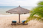 Two beach beds under sunshade on the beach, Sihanoukville, Cambodia — Stock Photo