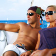 Foto Stock: Beautiful Couple resting on the Yacht
