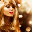 Blond Fashion Girl. Blonde Hair. Golden background — Stock Photo #11103638