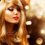 Blond Fashion Girl. Blonde Hair. Golden background — Stock Photo