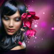 Fashion Brunette Girl with Magnolia Flowers — Stock Photo