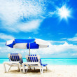 图库照片: Vacation and Tourism concept. Sunbed on beach