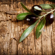Olives over Old Wood Background - Stock Photo