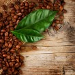 Stock Photo: Coffee Border design. Beans and Leaf over Wood Background