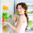 Stock Photo: Beautiful Young Woman near the Refrigerator with healthy food