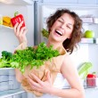 Beautiful Young Woman near the Refrigerator with healthy food — Stock Photo #11104389