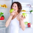 Beautiful Young Woman near the Refrigerator with healthy food — Stock Photo
