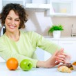 Beautiful Young Woman choosing between Fruits and Sweets — Stock Photo