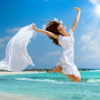 Beautiful Girl With White Scarf Jumping on The Beach — Stock Photo