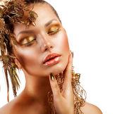 Golden Luxury Makeup. Fashion Girl Portrait — Stock Photo