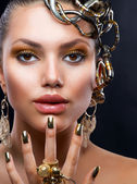 Golden Makeup and Jewelry. Fashion Model Portrait — Stock Photo
