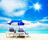 Vacation and Tourism concept. Sunbed on the beach — Stock Photo