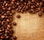 Coffee Border design. Beans over Burlap Background — Stock Photo