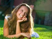 Beautiful Girl lying on the Field. Happiness — Stock Photo