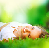 Spring Girl lying on the Field. Happiness — Stok fotoğraf