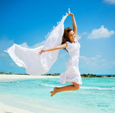 Beautiful Girl With White Scarf Jumping on The Beach — Stockfoto