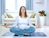 Beautiful Pregnant Woman Doing Yoga at Home — Stok fotoğraf