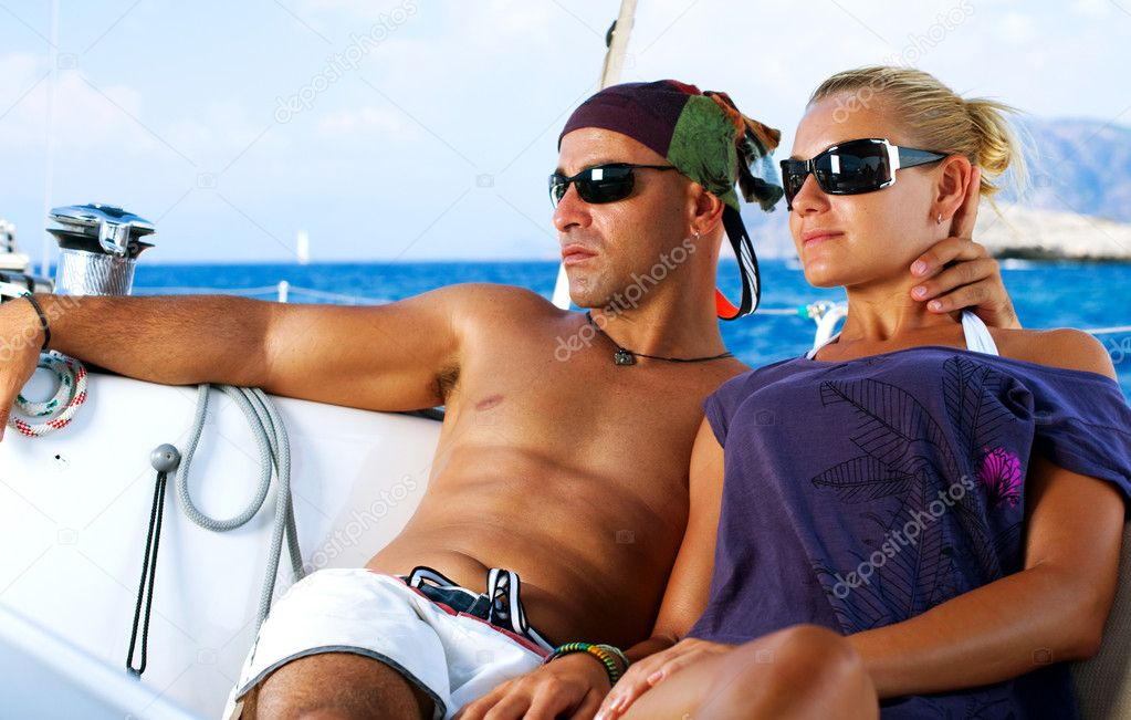 Beautiful Couple resting on the Yacht — Foto Stock #11103569