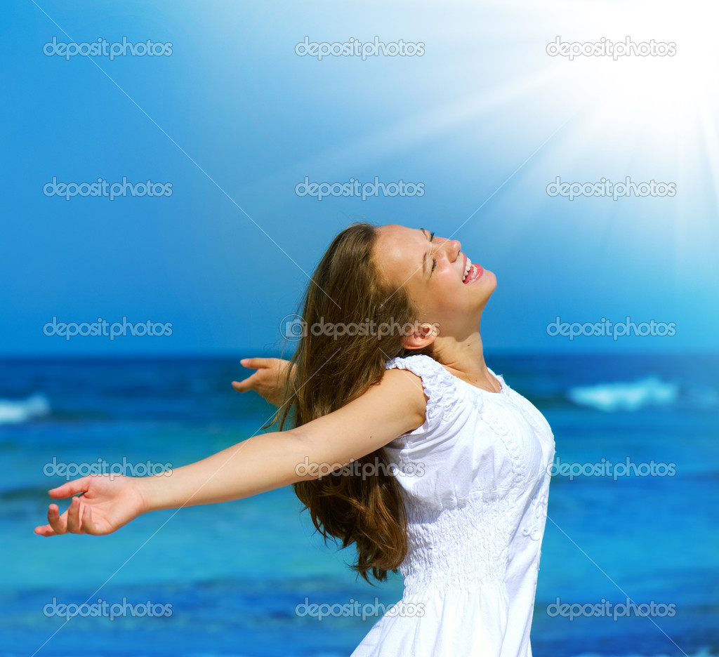 Beautiful Girl on the Ocean Beach. Travel or Vacation Concept  Stock Photo #11104604