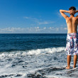 Mann in Badehose am Strand — Stockfoto #10839475
